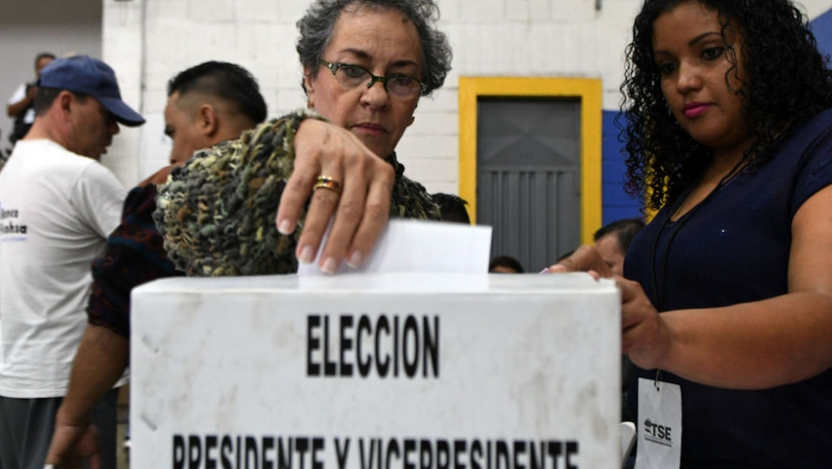 "A voter casts her ballot at a polling station in Tegucigalpa during the general election on November 26, 2017. Honduras' six million voters are to cast ballots in a controversial election Sunday in which President Juan Orlando Hernandez is seeking a second mandate despite a constitutional one-term limit. This small country is at the heart of Central America's ""triangle of death,"" an area plagued by gangs and poverty. / AFP PHOTO / ORLANDO SIERRA (Photo credit should read ORLANDO SIERRA/AFP/Getty Images)"