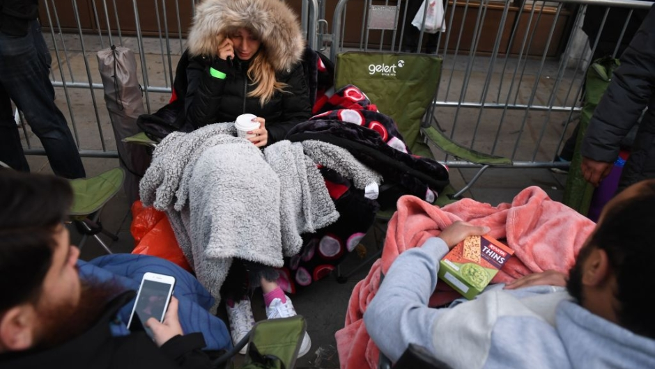 People queue outside Apple's Regent Street store in central London on November 3, 2017 waiting for the store to open on the say of the launch of the Apple iPhone X. Apple's flagship iPhone X hit stores on November 3, as the world's most valuable company predicted bumper sales despite the handset's eye-watering price tag and celebrated a surge in profits. The device features facial recognition, cordless charging and an edge-to-edge screen made of organic light-emitting diodes used in high-end televisions. It marks the 10th anniversary of the first iPhone release and is released in about 50 markets around the world. / AFP PHOTO / Chris J Ratcliffe (Photo credit should read CHRIS J RATCLIFFE/AFP/Getty Images)