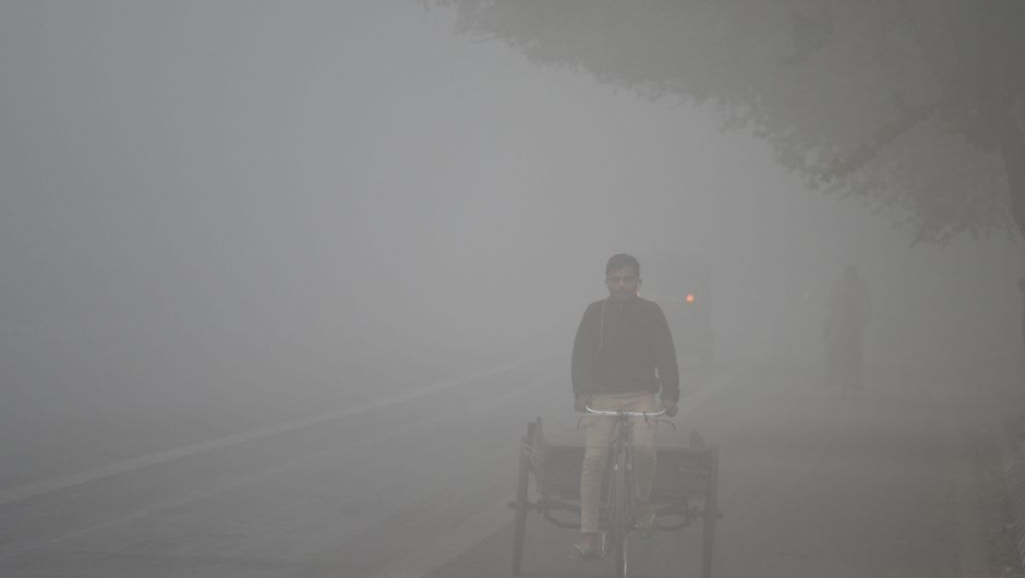 An Indian labourer drives a rickshaw amid heavy smog in New Delhi on November 8, 2017. Delhi shut all primary schools on November 8 as pollution levels hit nearly 30 times the World Health Organization safe level, prompting doctors in the Indian capital to warn of a public health emergency. Dense grey smog shrouded the roads of the world's most polluted capital, where many pedestrians and bikers wore masks or covered their mouths with handkerchiefs and scarves. / AFP PHOTO / SAJJAD HUSSAIN (Photo credit should read SAJJAD HUSSAIN/AFP/Getty Images)