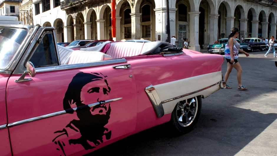 View of a classic American car decorated with the image of late Cuban leader Fidel Castro in Havana, on November 24, 2017. Cuba commemorates on November 25 the first anniversary of the death of Fidel Castro, focused on an electoral process that will imply a presidential change, in a framework of economic regression, hostility from the United States, and stagnation in its reforms. / AFP PHOTO / YAMIL LAGE (Photo credit should read YAMIL LAGE/AFP/Getty Images)