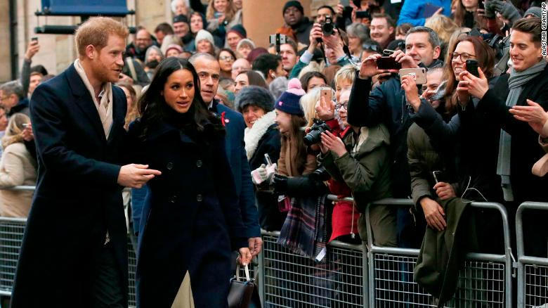 Britain's Prince Harry and his fiancee Meghan Markle arrive at the Terrence Higgins Trust World AIDS Day charity fair, in Nottingham, England, Friday, Dec. 1, 2017. The couple are taking part in their first official visit together, choosing to raise awareness of HIV/AIDS with a visit to a youth project in Nottingham.(AP Photo/Alastair Grant)