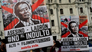 "Demonstrators protest against pardon of former President Alberto Fujimori in Lima, Peru, Monday, Dec. 25, 2017. Peru's President Pedro Pablo Kuczynski announced Sunday night that he granted a medical pardon to the jailed former strongman who was serving a 25-year sentence for human rights abuses, corruption and the sanctioning of death squads. The poster reads in spanih: ""Assassin, Thief, Not to pardon"".(AP Photo/Martin Mejia)"