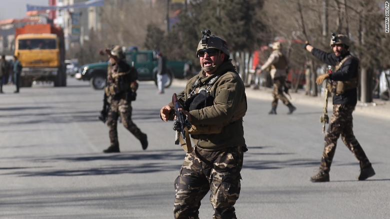 Security personnel arrive outside the site of a suicide attack in kabul, Afghanistan, Thursday, Dec. 28, 2017. Authorities say an attack took place on a Shiite cultural center in the Afghan capital killing and wounding dozens. (AP Photo/ Rahmat Gul)