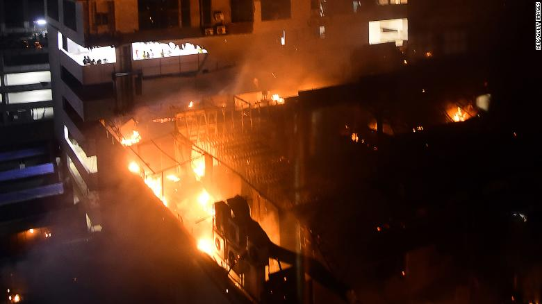 TOPSHOT - EDITORS NOTE: Graphic content / A general view of a building on fire where a rooftop party was being held in Mumbai early on December 29, 2017. At least 14 people were killed when a huge blaze tore through a popular restaurant in Mumbai early December 29, police said, in the latest disaster to raise concerns over fire safety in India. / AFP PHOTO / - (Photo credit should read -/AFP/Getty Images)