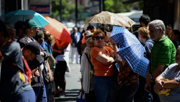 People queue outside a supermarket in Caracas to buy basic foodstuffs and household products on November 10, 2017. In crisis-stricken Venezuela, the cost of the basic basket of goods soared to nearly 2.7 million bolivars in September, the equivalent of six minimum monthly wages. / AFP PHOTO / FEDERICO PARRA (Photo credit should read FEDERICO PARRA/AFP/Getty Images)