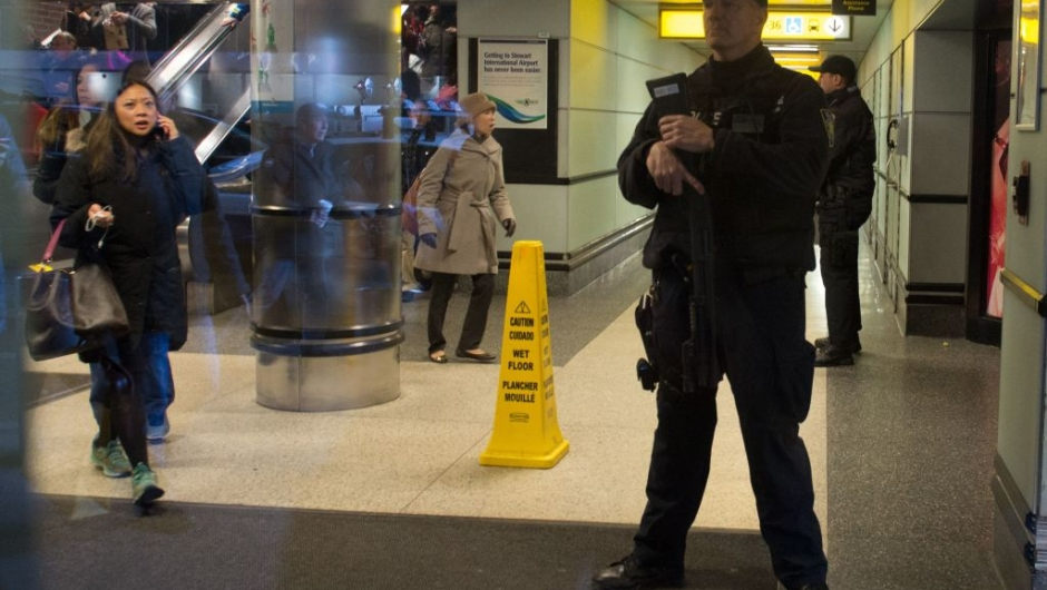 "Port Authority Police watch as people evacuate after a reported explosion at the Port Authority Bus Terminal on December 11, 2017 in New York. New York police said Monday that they were investigating an explosion of ""unknown origin"" in busy downtown Manhattan, and that people were being evacuated. Media reports said at least one person had been detained after the blast near the Port Authority transit terminal, close to Times Square.Early media reports said the blast came from a pipe bomb, and that several people were injured. / AFP PHOTO / Bryan R. Smith (Photo credit should read BRYAN R. SMITH/AFP/Getty Images)"
