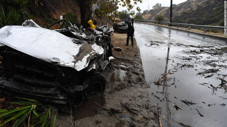 Mud fills a street after a rain-driven mudslide destroyed two cars and damaged property in a neighborhood under mandatory evacuation in Burbank, California, January 9, 2018. Mudslides unleashed by a ferocious storm demolished homes in southern California, authorities said Tuesday. Five people were reported killed. / AFP PHOTO / Robyn Beck (Photo credit should read ROBYN BECK/AFP/Getty Images)