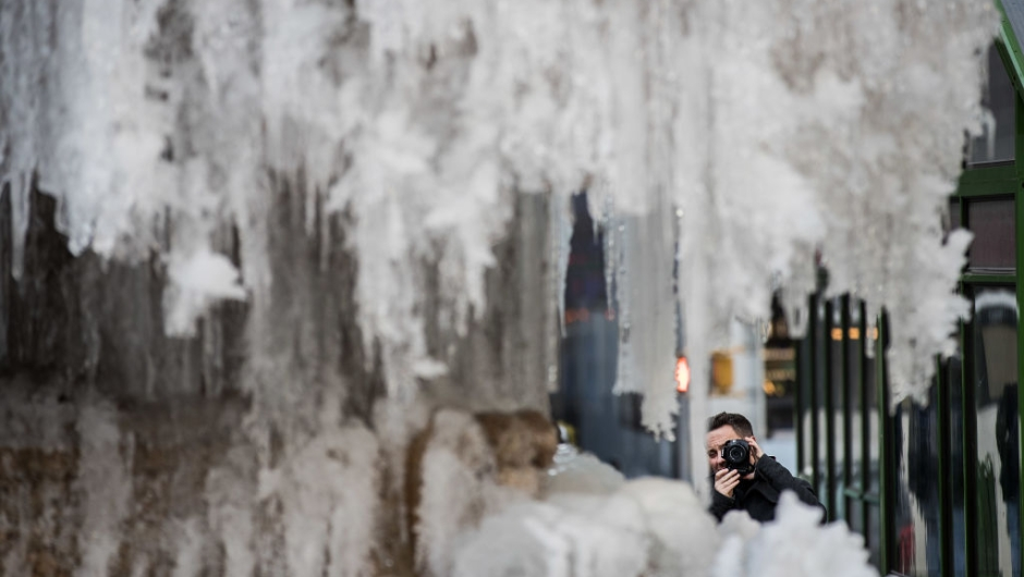 NEW YORK, NY - JANUARY 03: A man photographs a frozen fountain in Bryant Park, January 3, 2018 in New York City. New York City was placed under a winter storm watch Wednesday as a major weather system is expected to threaten the area with heavy snow and powerful wind Wednesday night into Thursday. (Photo by Drew Angerer/Getty Images)