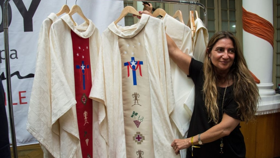 An employee of the episcopate shows the papal vestments to be used by Pope Francis during his upcoming visit to Chile, in Santiago, on January 8, 2018. Pope Francis will be visiting Chile from January 15 to 18. / AFP PHOTO / Martin BERNETTI (Photo credit should read MARTIN BERNETTI/AFP/Getty Images)
