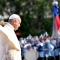 Pope Francis is welcomed by Chile's President Michelle Bachelet (covered) during a ceremony at La Moneda Presidential Palace in Santiago on January 16, 2018. The pope landed in Santiago late Monday on his first visit to Chile since becoming pope, and his sixth to Latin America - a trip that will also take him to Peru. / AFP PHOTO / POOL / Vincenzo PINTO (Photo credit should read VINCENZO PINTO/AFP/Getty Images)