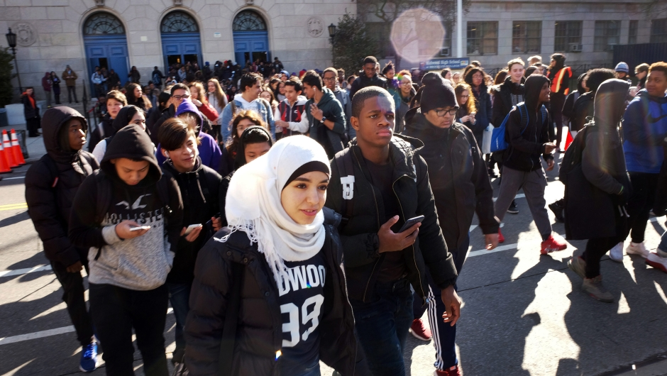 Hundreds of students walk out of Midwood High School as part of a nationwide protest against gun violence, Wednesday, March 14, 2018, in the Brooklyn borough of New York. It is the nation's biggest demonstration yet of the student activism that has emerged in response to last month's massacre of 17 people at Florida's Marjory Stoneman Douglas High School. (AP Photo/Mark Lennihan)