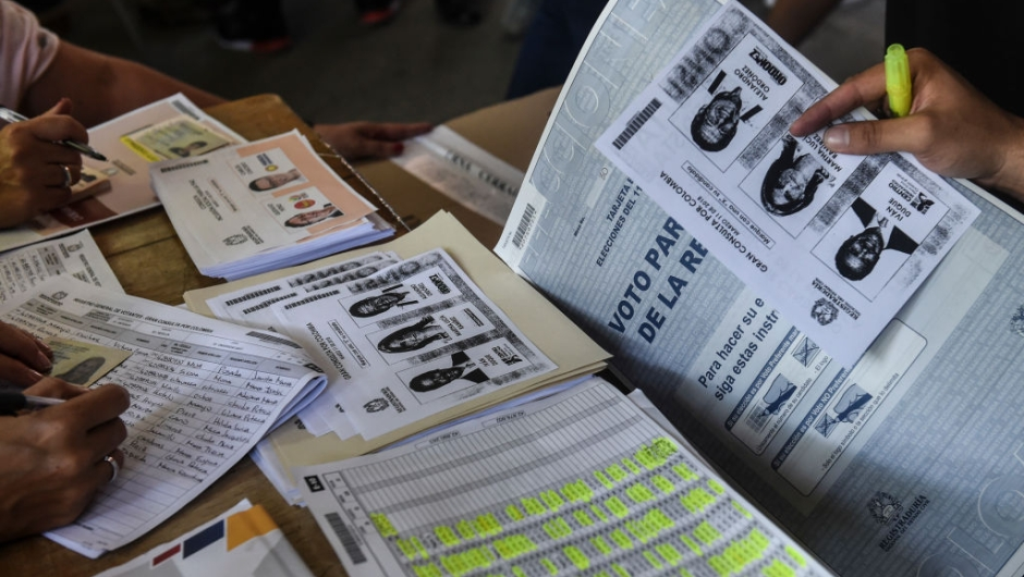 Photocopies of ballots for one of the two main political blocs holding primary elections at the same time of the parliamentary elections in Colombia, are available at a polling station after the originals ran out, in Medellin, Antioquia Department, Colombia, on March 11, 2018. Colombians went to the polls Sunday to elect a new Congress with a resurgent right, bitterly opposed to a peace deal that allows leftist former rebels to participate, expected to poll strongly. The election is set to be the calmest in half a century of conflict in Colombia, with the former rebel movement FARC spurning jungle warfare for politics, and the ELN -- the country's last active rebel group -- observing a ceasefire. / AFP PHOTO / Joaquin SARMIENTO (Photo credit should read JOAQUIN SARMIENTO/AFP/Getty Images)