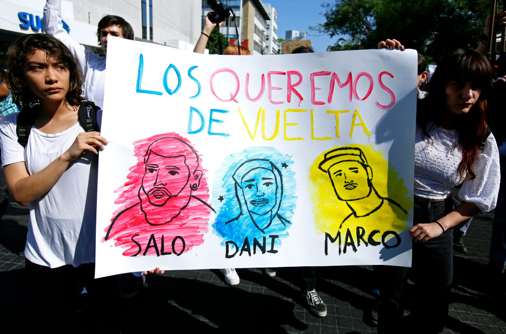 Students take part in a protest to demand the appearance of three missing film students alive, three days after they went missing in Guadalajara, Jalisco state, Mexico, on March 22, 2018. Three film students from the University of Audiovisual Media of Jalisco state went missing last Monday. According to the denounce they were intercepted when they were returning from a shooting in the western locality of Tonala. Mexican Oscar-winning director Guillermo del Toro, native from Guadalajara, joined in the claim through Twitter. / AFP PHOTO / Ulises Ruiz (Photo credit should read ULISES RUIZ/AFP/Getty Images)