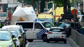 "Police and ambulance are seen at the site where a gunman shot dead three people, two of them policemen, before being killed by elite officers, in the eastern Belgian city of Liege on May 29, 2018. - The shooting occurred around 10:30am (0830 GMT) on a major artery in the city close to a high school. ""We don't know anything yet,"" the spokeswoman for the Liege prosecutors office, told AFP when asked about the shooter's motives. (Photo by JOHN THYS / AFP) (Photo credit should read JOHN THYS/AFP/Getty Images)"