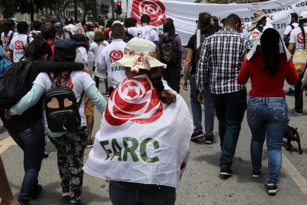 Marcha del 1 de mayo en Medellín con miembros del partido político FARC. (Crédito: JOAQUIN SARMIENTO/AFP/Getty Images)