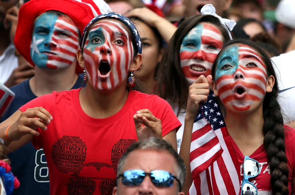 SAN FRANCISCO, CA - JULY 01: Soccer fans react as they watch a live simulcast of the FIFA World Cup quarter final match between USA and Belgium at the Civic Center plaza on July 1, 2014 in San Francisco, United States. Thousands of soccer fans came out to watch a live simulcast of the FIFA World Cup quarter finals match with USA and Belgium. Belgium defated USA 2-1. (Photo by Justin Sullivan/Getty Images)