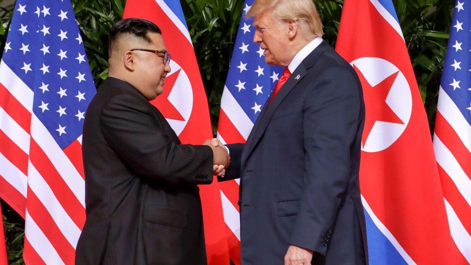 U.S. President Donald Trump shakes hands with North Korea leader Kim Jong Un at the Capella resort on Sentosa Island Tuesday, June 12, 2018 in Singapore. (AP Photo/Evan Vucci)