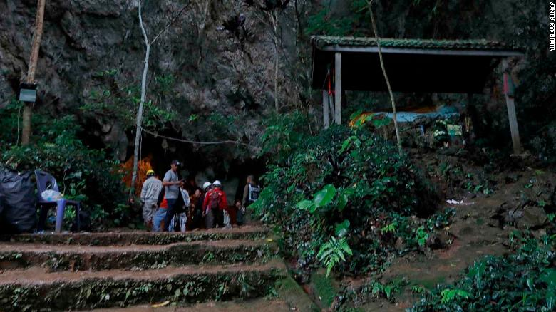 Rescue teams gather at the entrance of a deep cave where a group of boys went missing in Chiang Rai, northern Thailand, Monday, June 25, 2018. Officials say multiple attempts to locate the 12 boys and their soccer coach missing in a flooded cave in northern Thailand for nearly two days have failed, but that they will keep trying. (Thai News Pix via AP)