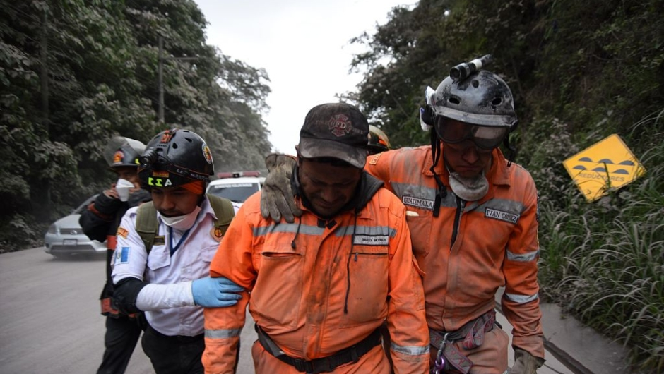 TOPSHOT - A volunteer firefighter cries after leaving El Rodeo village in Escuintla department, 35 km south of Guatemala City on June 3, 2018, following the eruption of the Fuego Volcano. (Photo by ORLANDO ESTRADA / AFP) (Photo credit should read ORLANDO ESTRADA/AFP/Getty Images)