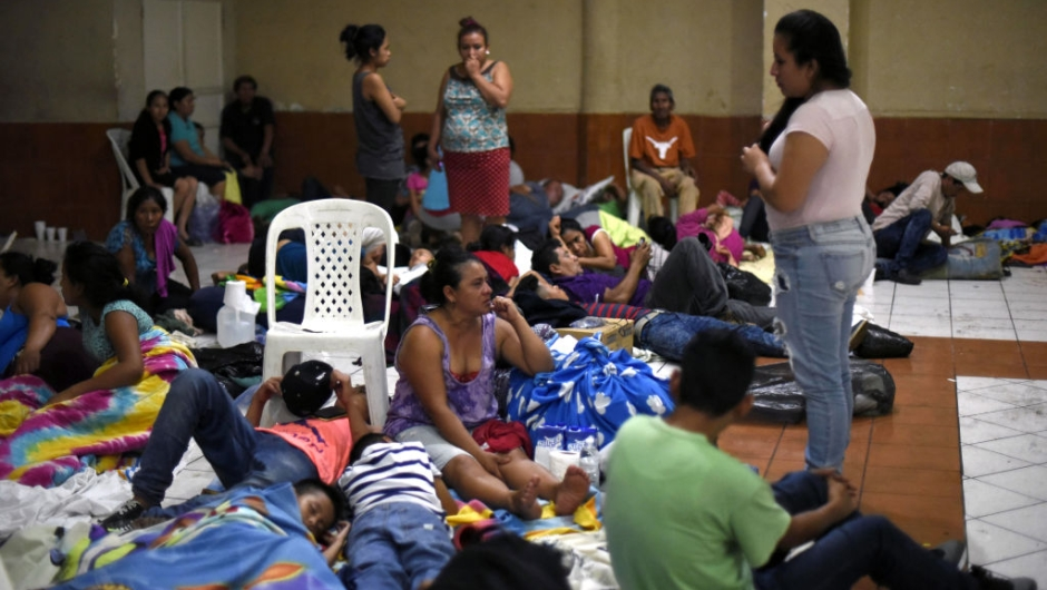 EDITORS NOTE: Graphic content / Residents of several communities safeguard in a temporary shelter in Escuintla department, 35 km south of Guatemala City on June 3, 2018, for fear of new outbursts of Fuego volcano. - At least 25 people were killed, according to the National Coordinator for Disaster Reduction (Conred), when Guatemala's Fuego volcano erupted Sunday, belching ash and rock and forcing the airport to close. (Photo by JOHAN ORDONEZ / AFP) (Photo credit should read JOHAN ORDONEZ/AFP/Getty Images)