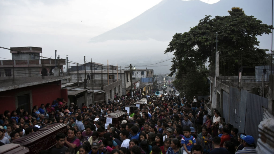 Residents carry the coffins of seven people who died following the eruption of the Fuego volcano, along the streets of Alotenango municipality, Sacatepequez, about 65 km southwest of Guatemala City, on June 4, 2018. - Rescue workers Monday pulled more bodies from under the dust and rubble left by an explosive eruption of Guatemala's Fuego volcano, bringing the death toll to at least 62. (Photo by JOHAN ORDONEZ / AFP) (Photo credit should read JOHAN ORDONEZ/AFP/Getty Images)