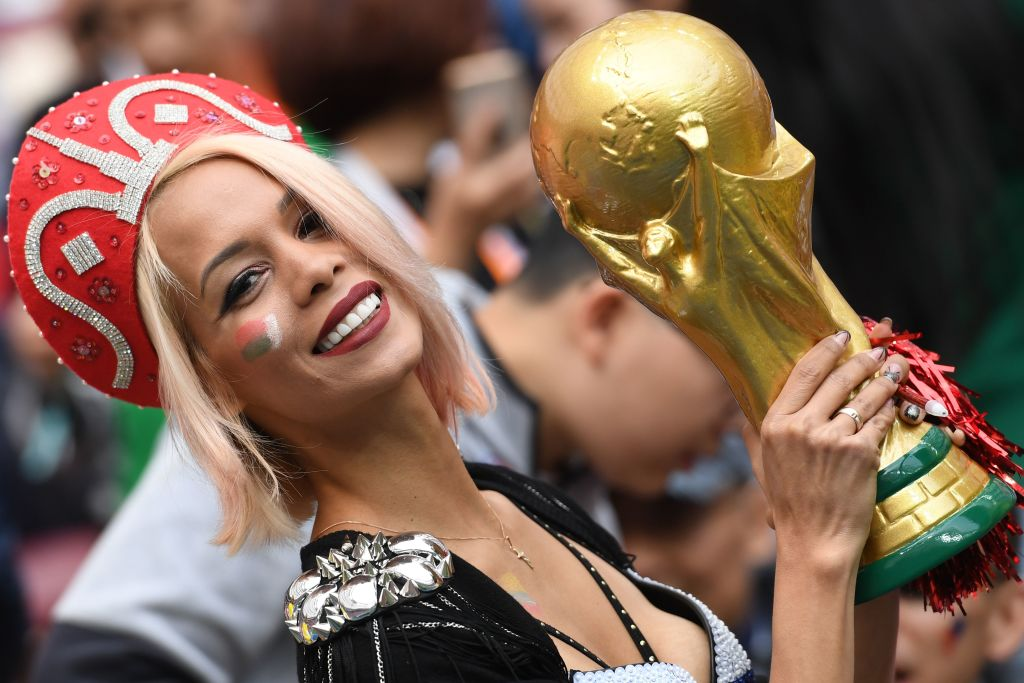 A Russian fan holds a replica of the FIFA 2018 World Cup trophy before the Russia 2018 World Cup Group A football match between Russia and Saudi Arabia at the Luzhniki Stadium in Moscow on June 14, 2018. (Photo by Kirill KUDRYAVTSEV / AFP) / RESTRICTED TO EDITORIAL USE - NO MOBILE PUSH ALERTS/DOWNLOADS (Photo credit should read KIRILL KUDRYAVTSEV/AFP/Getty Images)