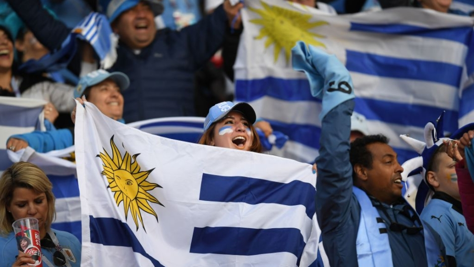 Uruguay fans hold flags before kick off of the Russia 2018 World Cup Group A football match between Egypt and Uruguay at the Ekaterinburg Arena in Ekaterinburg on June 15, 2018. (Photo by JORGE GUERRERO / AFP) / RESTRICTED TO EDITORIAL USE - NO MOBILE PUSH ALERTS/DOWNLOADS (Photo credit should read JORGE GUERRERO/AFP/Getty Images)