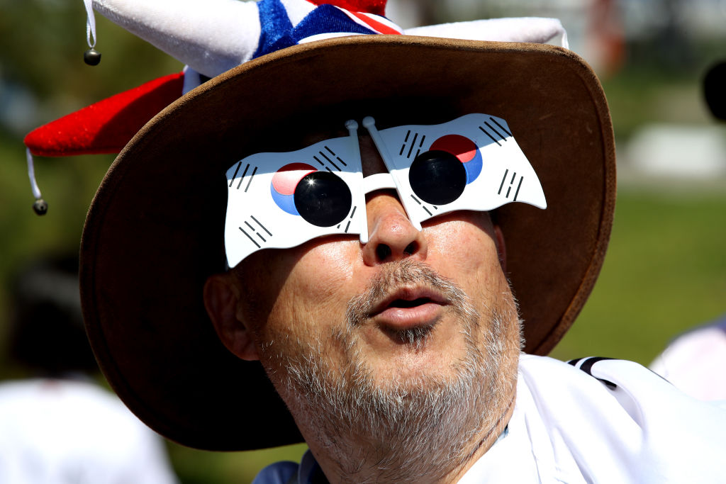 NIZHNIY NOVGOROD, RUSSIA - JUNE 18: A Korea Republic fan enjoys the pre match atmosphere during the 2018 FIFA World Cup Russia group F match between Sweden and Korea Republic at Nizhniy Novgorod Stadium on June 18, 2018 in Nizhniy Novgorod, Russia. (Photo by Clive Brunskill/Getty Images)