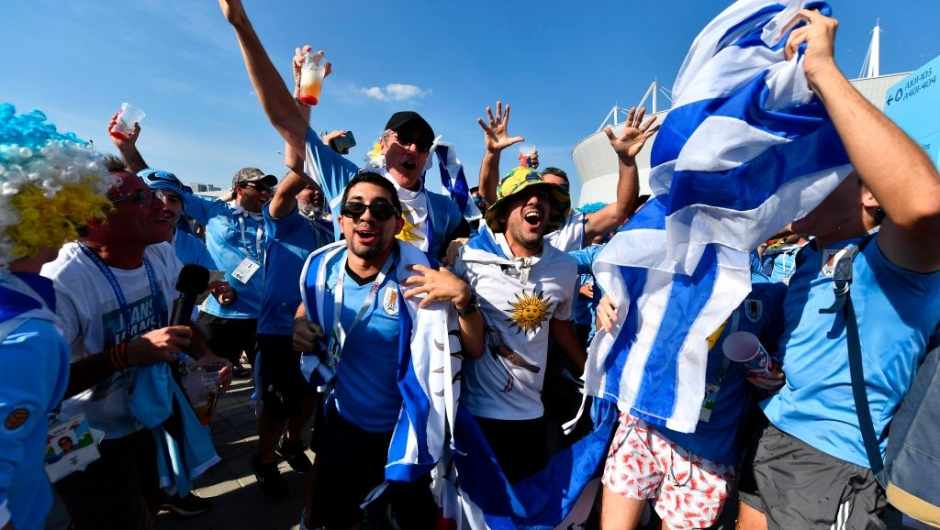 Uruguay fans cheer outside the stadium before the Russia 2018 World Cup Group A football match between Uruguay and Saudi Arabia at the Rostov Arena in Rostov-On-Don on June 20, 2018. (Photo by JOE KLAMAR / AFP) / RESTRICTED TO EDITORIAL USE - NO MOBILE PUSH ALERTS/DOWNLOADS (Photo credit should read JOE KLAMAR/AFP/Getty Images)