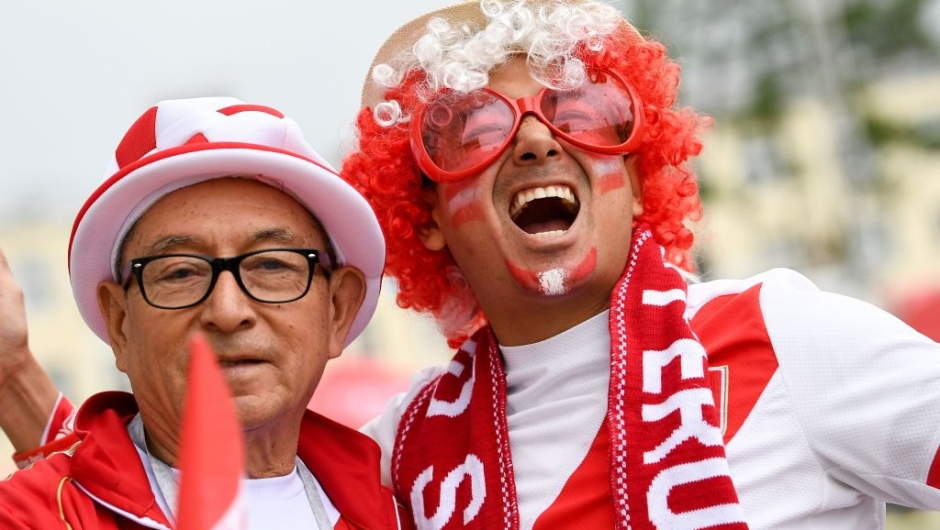 Peru's fans pose outside the stadium before the Russia 2018 World Cup Group C football match between France and Peru at the Ekaterinburg Arena in Ekaterinburg on June 21, 2018. (Photo by FRANCK FIFE / AFP) / RESTRICTED TO EDITORIAL USE - NO MOBILE PUSH ALERTS/DOWNLOADS (Photo credit should read FRANCK FIFE/AFP/Getty Images)