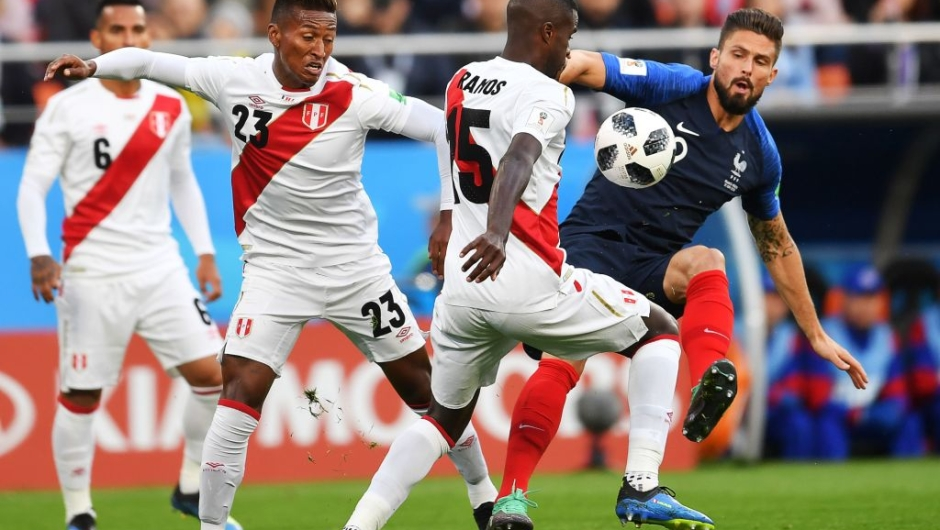 France's forward Olivier Giroud (R) compete for the ball during the Russia 2018 World Cup Group C football match between France and Peru at the Ekaterinburg Arena in Ekaterinburg on June 21, 2018. (Photo by HECTOR RETAMAL / AFP) / RESTRICTED TO EDITORIAL USE - NO MOBILE PUSH ALERTS/DOWNLOADS (Photo credit should read HECTOR RETAMAL/AFP/Getty Images)