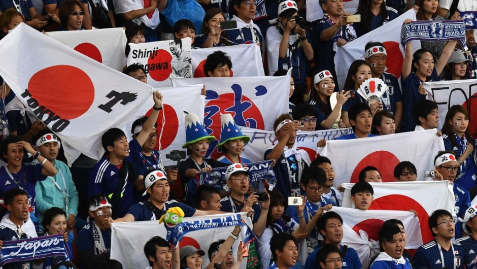 Japan fans cheer before the Russia 2018 World Cup Group H football match between Japan and Senegal at the Ekaterinburg Arena in Ekaterinburg on June 24, 2018. (Photo by Anne-Christine POUJOULAT / AFP) / RESTRICTED TO EDITORIAL USE - NO MOBILE PUSH ALERTS/DOWNLOADS (Photo credit should read ANNE-CHRISTINE POUJOULAT/AFP/Getty Images)