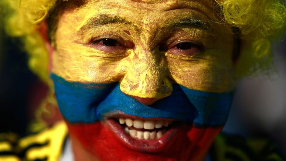 TOPSHOT - A Colombia's football fan poses before the Russia 2018 World Cup Group H football match between Poland and Colombia at the Kazan Arena in Kazan on June 24, 2018. (Photo by Benjamin CREMEL / AFP) / RESTRICTED TO EDITORIAL USE - NO MOBILE PUSH ALERTS/DOWNLOADS (Photo credit should read BENJAMIN CREMEL/AFP/Getty Images)