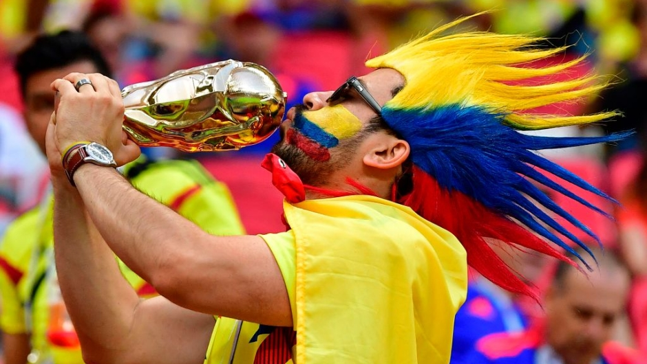 TOPSHOT - A Colombia fan poses with a replica World Cup in the crowd before kick off of the Russia 2018 World Cup Group H football match between Poland and Colombia at the Kazan Arena in Kazan on June 24, 2018. (Photo by Luis Acosta / AFP) / RESTRICTED TO EDITORIAL USE - NO MOBILE PUSH ALERTS/DOWNLOADS (Photo credit should read LUIS ACOSTA/AFP/Getty Images)