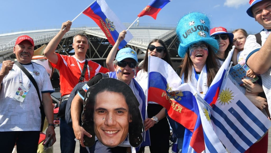 Uruguay and Russia supporters pose with a cardboard cutout of Urugay's forward Edinson Cavani outside the Samara Arena in Samara on June 25, 2018, prior to the Russia 2018 World Cup Group A football match between Uruguay and Russia. (Photo by EMMANUEL DUNAND / AFP) / RESTRICTED TO EDITORIAL USE - NO MOBILE PUSH ALERTS/DOWNLOADS (Photo credit should read EMMANUEL DUNAND/AFP/Getty Images)