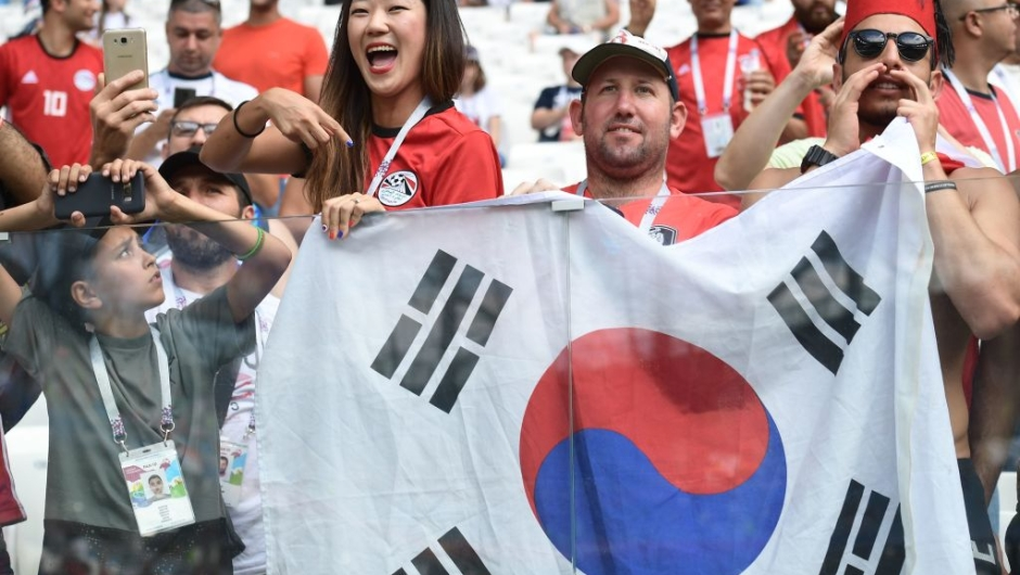 Fans hold the South Korea flag before the Russia 2018 World Cup Group A football match between Saudi Arabia and Egypt at the Volgograd Arena in Volgograd on June 25, 2018. (Photo by NICOLAS ASFOURI / AFP) / RESTRICTED TO EDITORIAL USE - NO MOBILE PUSH ALERTS/DOWNLOADS (Photo credit should read NICOLAS ASFOURI/AFP/Getty Images)