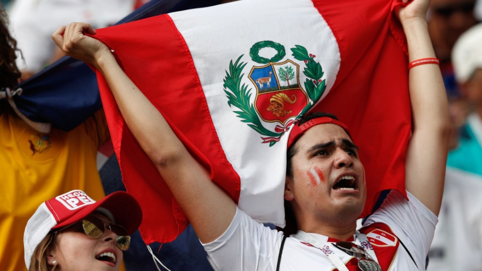 A Peru supporter holds a flag prior to the Russia 2018 World Cup Group C football match between Australia and Peru at the Fisht Stadium in Sochi on June 26, 2018. (Photo by Adrian DENNIS / AFP) / RESTRICTED TO EDITORIAL USE - NO MOBILE PUSH ALERTS/DOWNLOADS (Photo credit should read ADRIAN DENNIS/AFP/Getty Images)