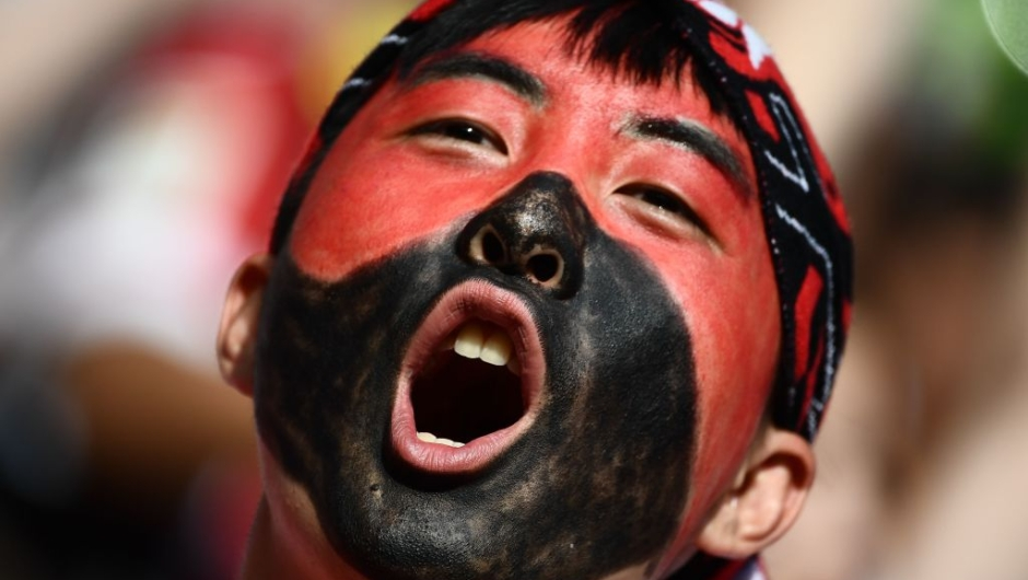 A fan cheers prior to the Russia 2018 World Cup Group F football match between South Korea and Germany at the Kazan Arena in Kazan on June 27, 2018. (Photo by Jewel SAMAD / AFP) / RESTRICTED TO EDITORIAL USE - NO MOBILE PUSH ALERTS/DOWNLOADS (Photo credit should read JEWEL SAMAD/AFP/Getty Images)