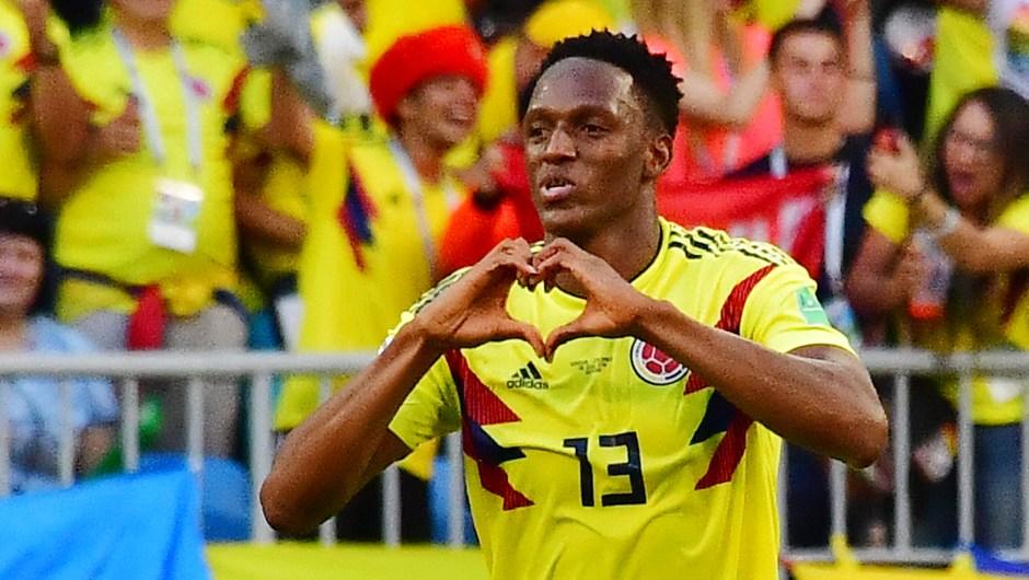 Yerry Mina de Colombia hace la forma de un corazón tras el gol en el partido contra Senegal. (Crédito: LUIS ACOSTA/AFP/Getty Images)