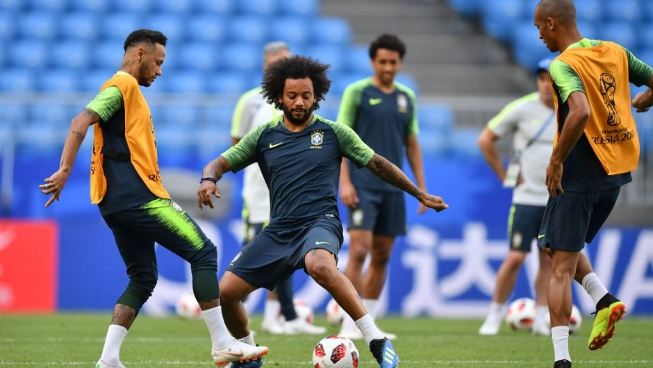 Brazil's forward Neymar (L) and Brazil's defender Marcelo (2nd L) take part in a training session at the Samara Arena in Samara on July 1, 2018, on the eve of their Russia 2018 World Cup round of 16 football match against Mexico. (Photo by Fabrice COFFRINI / AFP) (Photo credit should read FABRICE COFFRINI/AFP/Getty Images)