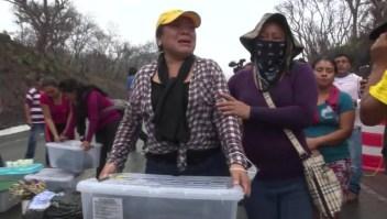 Sobrevivientes de la erupción del Volcán de Fuego protestan en Guatemala