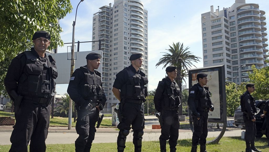 Security forces stand guard near Montevideo's World Trade Centre, which houses offices of the Israeli embassy, where a suspicious package was found by the K9 unit during a routine inspection on January 8, 2015. The artifact, which simulated an improvised explosive device, was defused by the Explosives Brigade, who suspect it was put to test the police response time. AFP PHOTO / Mario GOLDMAN (Photo credit should read MARIO GOLDMAN/AFP/Getty Images)