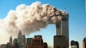 NEW YORK - SEPTEMBER 11, 2001: (SEPTEMBER 11 RETROSPECTIVE) Smoke pours from the twin towers of the World Trade Center after they were hit by two hijacked airliners in a terrorist attack September 11, 2001 in New York City. (Photo by Robert Giroux/Getty Images)