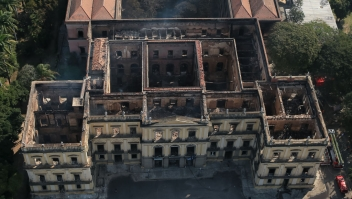 RIO DE JANEIRO, BRAZIL - SEPTEMBER 03: Aerial view of the damage to the National Museum of Brazil after a devastating fire on September 3, 2018 in Rio de Janeiro, Brazil. A cause to the catastrophic fire is still unknown. The museum, which is tied to the Rio de Janeiro federal university and the Education Ministry, was founded in 1818 by King John VI of Portugal and celebrated its 200th anniversary this year. It houses several landmark collections including Egyptian artifacts and the oldest human fossil found in Brazil. Its collection include more than 20 million items ranging from archaeological findings to historical memorabilia. (Photo by Buda Mendes/Getty Images)