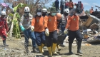 Rescuers work to search for survivors in Indonesia