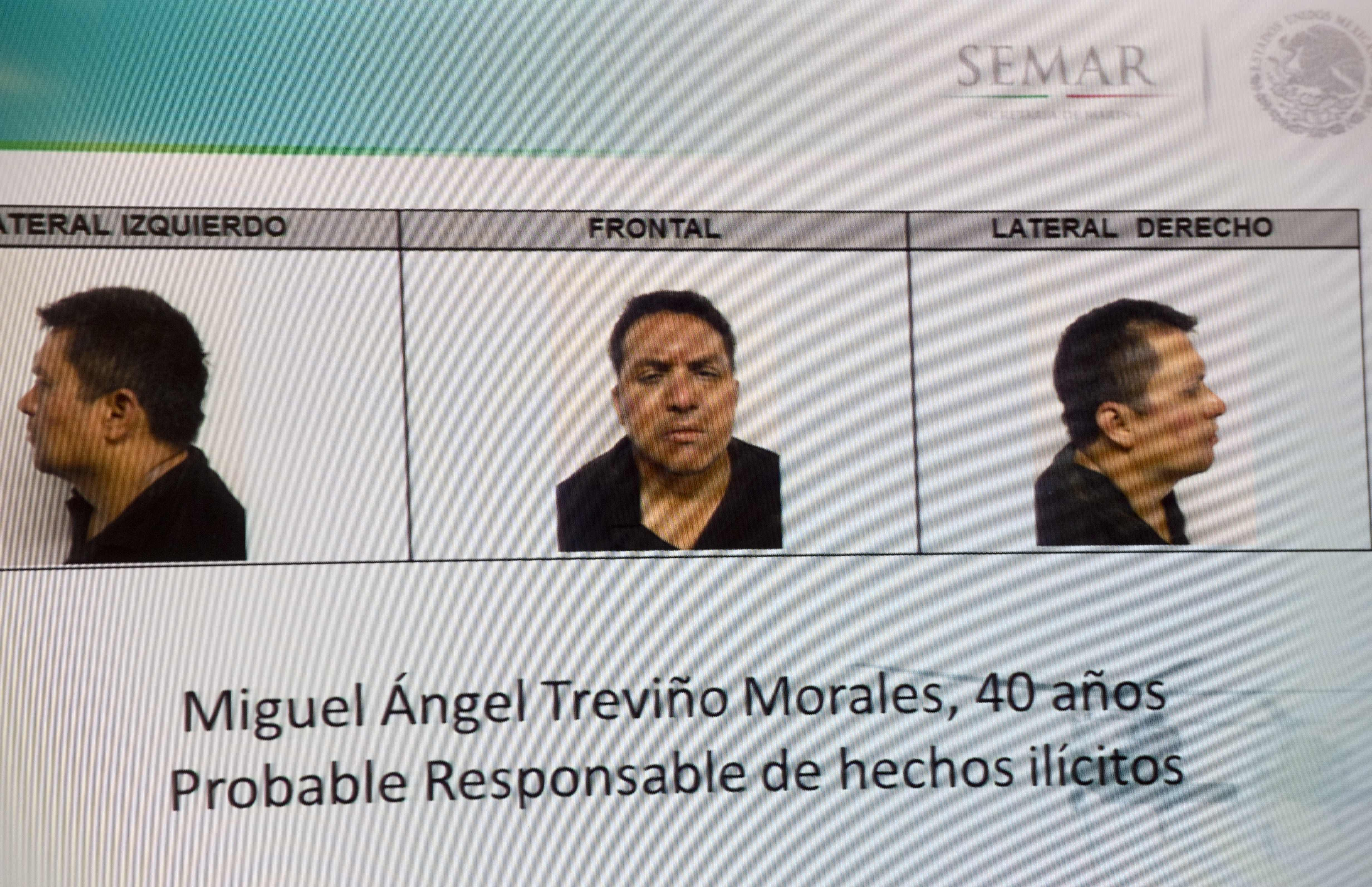 """Picture taken from a sreen of the alleged maximun leader of drugs Mexican cartel """"Los Zetas"""", Miguel Angel Trevino Morales, presented in combo pictures during a press conference at the head quarter of Interior Ministry on July 15, 2013 in Mexico City. According to a spokesman Trevino was arrested early morning during a military operation en Nuevo Laredo. AFP PHOTO/ Yuri CORTEZ (Photo credit should read YURI CORTEZ/AFP/Getty Images)"""