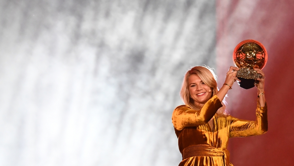 TOPSHOT - Olympique Lyonnais' Norwegian forward Ada Hegerberg brandishes her trophy after receiving the 2018 FIFA Women's Ballon d'Or award for best player of the year during the 2018 FIFA Ballon d'Or award ceremony at the Grand Palais in Paris on December 3, 2018. - The winner of the 2018 Ballon d'Or will be revealed at a glittering ceremony in Paris on December 3 evening, with Croatia's Luka Modric and a host of French World Cup winners all hoping to finally end the 10-year duopoly of Cristiano Ronaldo and Lionel Messi. (Photo by FRANCK FIFE / AFP) (Photo credit should read FRANCK FIFE/AFP/Getty Images)