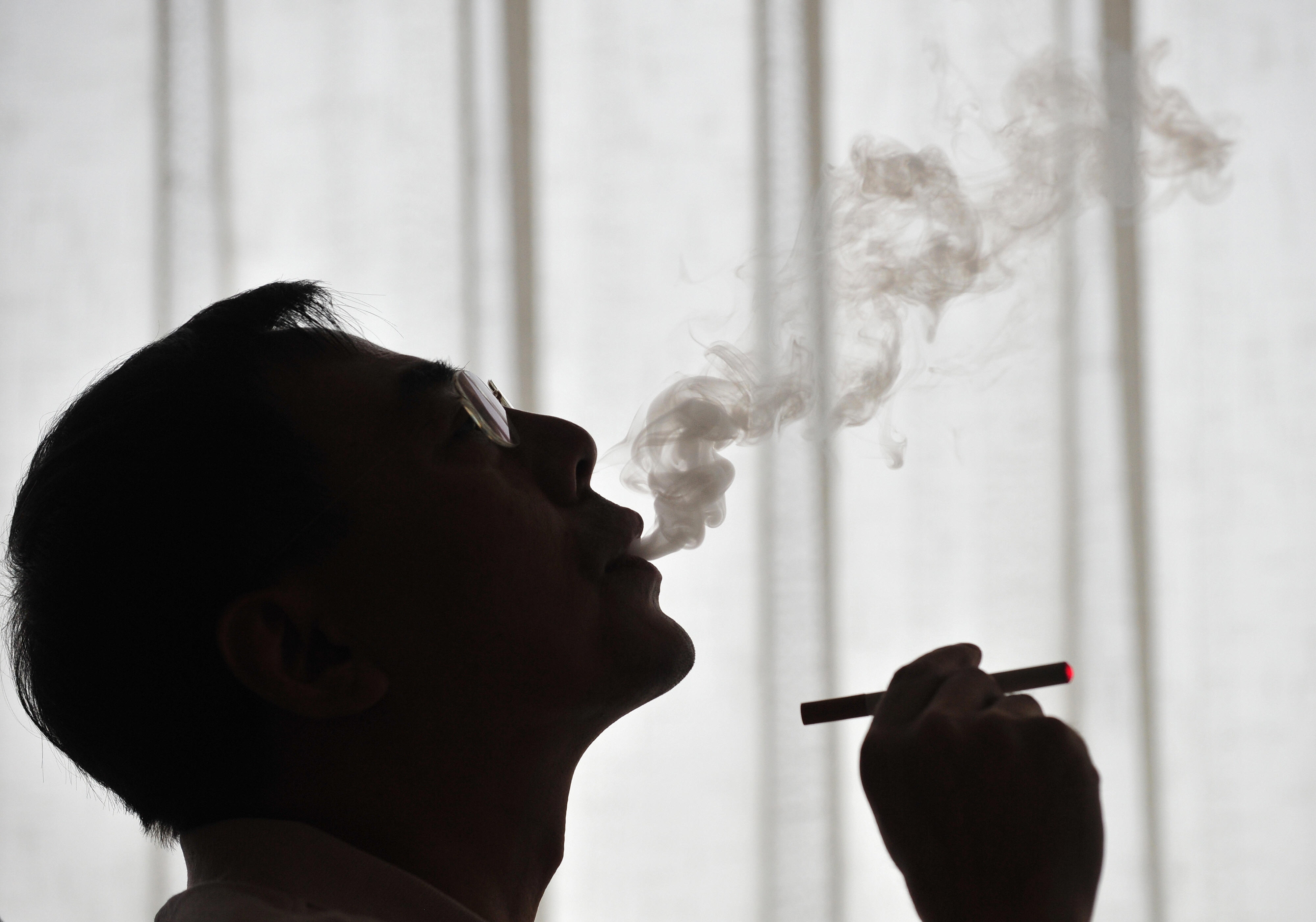 The inventor of the electronic cigarette, Hon Lik smokes his invention in Beiijng on May 25, 2009. Also known as an 'e-cigarette', the battery-powered device is designed as an alternative to cigarettes, cigars and pipes, and provides inhaled doses of nicotine by delivering a vaporized propylene glycol/nicotine solution, while also providing the physical sensation and flavors similar to inhaled tobacco smoke. With 350 million tobacco smokers nationwide, China will join the world in observing World No Tobacco Day on May 31. AFP PHOTO/Frederic J. BROWN (Photo credit should read FREDERIC J. BROWN/AFP/Getty Images)