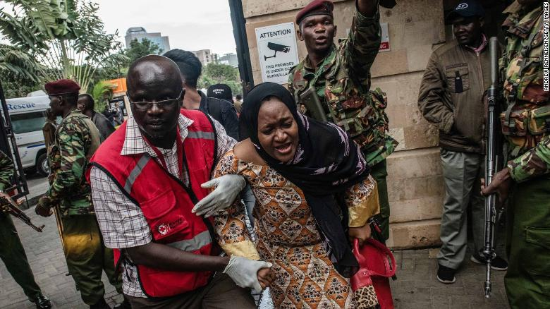 NAIROBI, KENYA - JANUARY 15: A woman is rescued from the Dusit Hotel on January 15, 2018 in Nairobi, Kenya. A current security operation is underway after terrorists attacked the hotel.