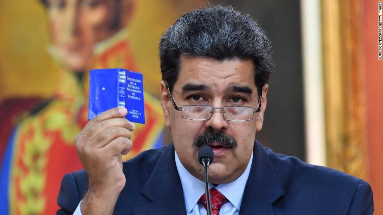 """Venezuelan President Nicolas Maduro offers a press conference in Caracas, on January 25, 2019. - Venezuela's opposition leader Juan Guaido called Friday for a """"major demonstration"""" next week to demand the resignation of President Nicolas Maduro, in his first public appearance since declaring himself """"acting president"""" two days ago. (Photo by Yuri CORTEZ / AFP) (Photo credit should read YURI CORTEZ/AFP/Getty Images)"""